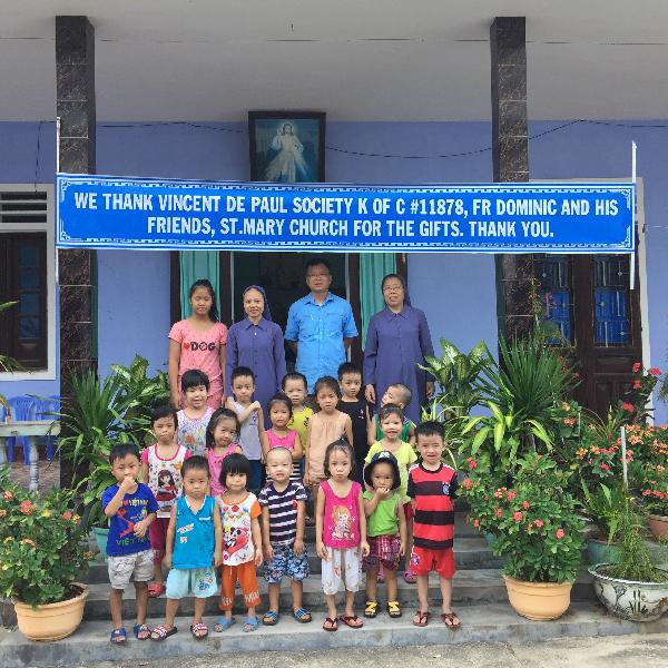 Father Dominic with the children in VietNam